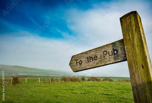 Fototapeta To the pub sign in rural setting obraz