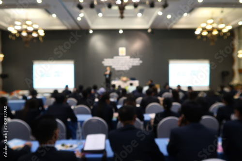 people attend conference in the meeting room , blurred background