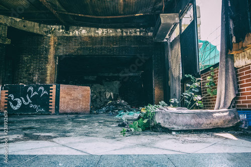 Canvas Prints Light pink Burned abandoned club with trash and mattress on the floor.