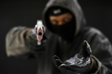 Robber With A Gun Robbing Inti...