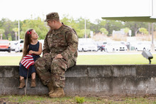 Soldier Sitting With His Daughter