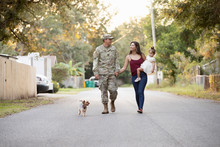 Soldier With His Family And Dog
