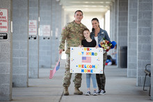 Soldier Reuniting With Daughter And Wife