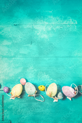 Fotobehang Zuivelproducten Easter eggs on bright blue background