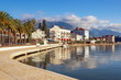 Beautiful Mediterranean landscape on sunny winter day. Montenegro, embankment of Tivat city and peaks of Lovcen mountain