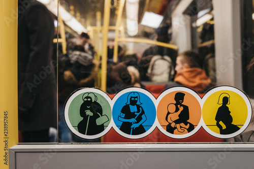 Fotografie, Obraz  Stickers asking to give up seat to concessions inside tube carriage in Vienna, Austria