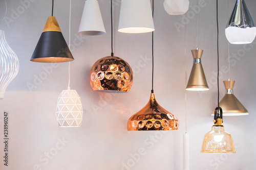 Fotomural  Different modern streamlined mirror copper chandeliers