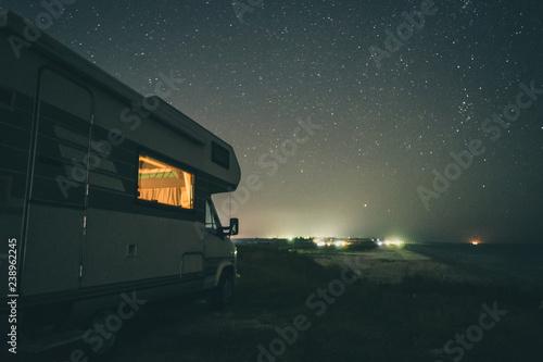 Slika na platnu Camping with motorhome by the sea. Night scenery.