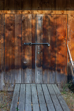 Brown Antique Wood Shed With Wooden Walkway