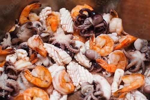Fotobehang Schaaldieren Stir fried mixed seafood. Shrimp, squid and octopus