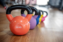 Colorful Kettlebells In A Row On Floor In A Gym, Green, Violet, Blue,yellow, Pink,