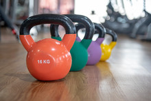 Colorful Kettlebells In A Row On Floor In A Gym, Green, Violet, Blue,yellow,
