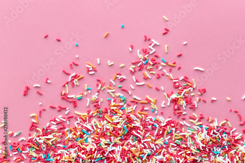 Cuadros en Lienzo Colorful sprinkles on a pink background, top view with copy space