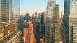 Aerial drone footage of New York skyline along 42nd street canyon, with pull back camera motion