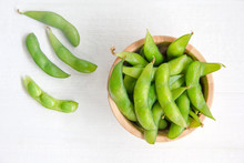 Edamame, Japanese Green Beans In Wooden Bowl On White Background