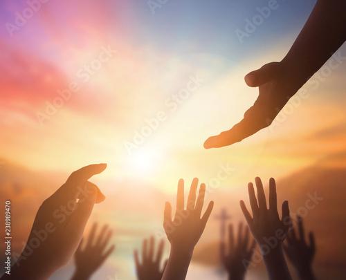 Vászonkép International Human Solidarity Day concept:  helping hand concept and internatio
