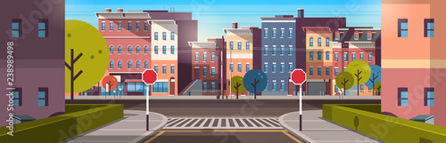 Fototapeta city street building houses architecture empty downtown road urban cityscape early morning sunrise horizontal banner flat obraz