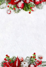 Christmas Decoration. Frame Of Flower Of Red Poinsettia, Twigs Christmas Tree, Christmas Red Balls, Cones Pine And Red Berries Covered Snow On Snow With Space For Text. Top View, Flat Lay