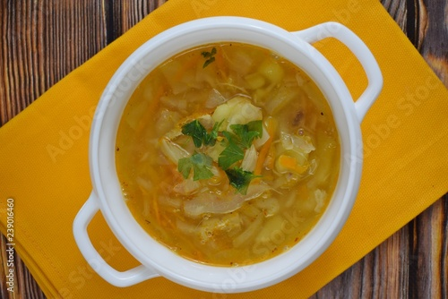 Delicious homemade soup from fresh cabbage on a wooden background Poster Mural XXL