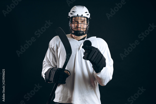 Handsome hockey player looking at camera asking the supporters if there is so any interest in going to that hockey game