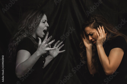 Photo  Alterego girl, one side of girl screaming and another side is scared