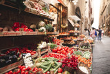 Fototapeta Uliczki - Beautiful fresh vegetables are sold in the street market on the narrow streets of the European town. Fresh vegetables are sold on the streets of Florence, Italy
