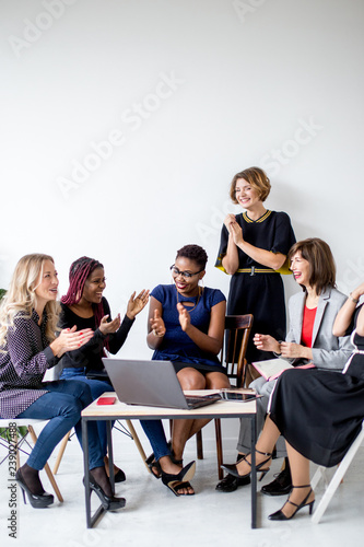Fototapety, obrazy: Women talking with cheerfulness about progress at solving family problems. during meeting of support group with psychotherapist
