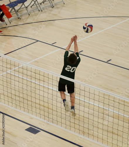 Volleyball player back setting