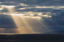 Sun Rays Are Shining Through The Clouds