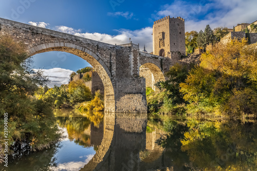 The Puente de Alcantara, a Roman arch bridge in Toledo, Catile-La Mancha, Spain, spanning the Tagus River. The word comes from Arabic bridge