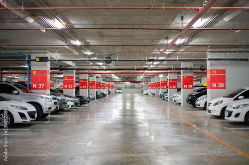 Fototapeta Blurred image/ Parking garage - interior shot of multi-story car park, underground parking with cars