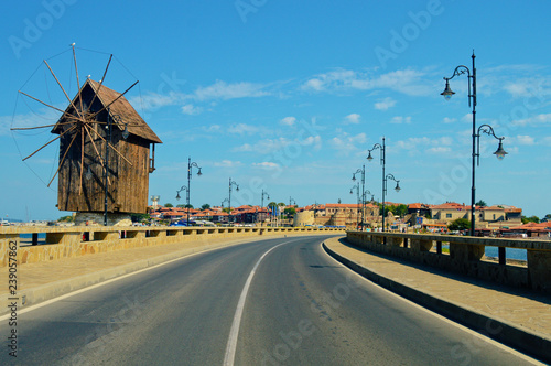 Poster Mills welcome to Nessebar- old Bulgarian town, windmill and road view, travelling concept