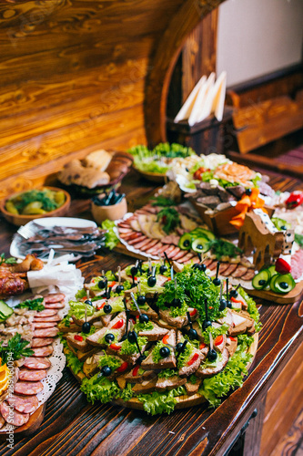 In de dag Asia land Buffet table of reception with burgers, cold snacks, meat and salads