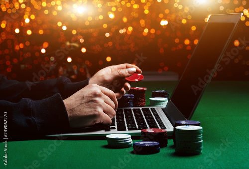 Fotografie, Obraz  Person playing online poker and looking winning cards