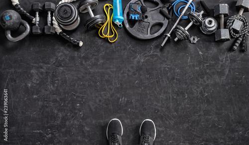 Fotografía Sports equipment on a black background. Top view. Motivation