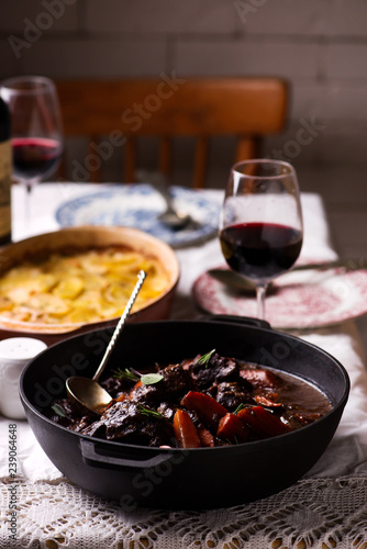 Beef cheeks in red wine with carrots and potato gratin.
