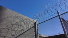 Barbed Wire On Top Of Border Wall