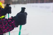Hand And Ski Pole With Selective Focus.