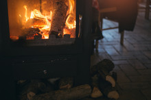 Retro Iron Wood Stove Burning Wooden Logs, Cosy Winter Atmosphere.