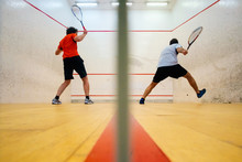 Two Friends Playing Squash In ...