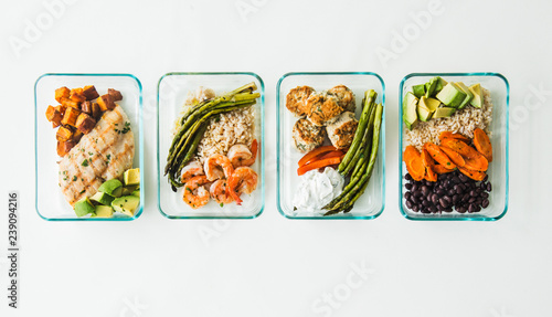 Meal prep containers filled with healthy lunches - 239094216