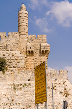 Street Sign In Front Of The Tower Of David And Old City Walls In Jerusalem, Israel