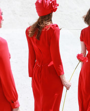 Rear View Of Woman In Red Dres...