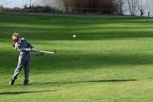 Junior Golfer Chipping