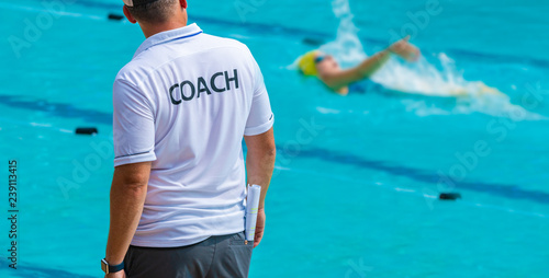 Photo Back view of sport coaches