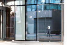 Modern Glass Entrance Of An Office Building
