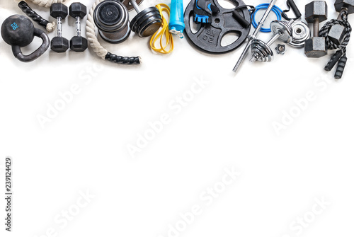 Fotomural  Sports equipment on a white background. Top view. Motivation
