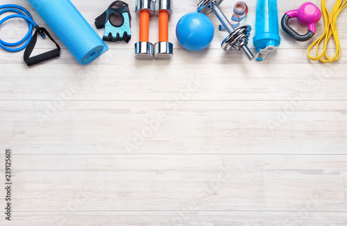 Stampa su Tela Sports equipment on a white wooden background