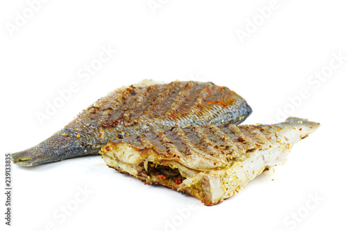 Fotografie, Obraz  Grilled dorado fishes isolated on white background.