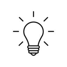 Black Isolated Outline Icon Of Light Bulb On White Background. Line Icon Illuminated Lamp. Symbol Of Idea, Creative.